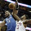 Minnesota Timberwolves\' Nikola Pekovic (14), from Montenegro, and Cleveland Cavaliers\' Tristan Thompson (13) battle for a rebound during the first quarter of an NBA basketball game Monday, Feb. 11, 2013, in Cleveland. (AP Photo/Tony Dejak)