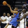 Oklahoma City Thunder guard Russell Westbrook, center, gets a pass off under pressure from Memphis Grizzlies defenders Michael Conley, left, and Zach Randolph during the second half of a preseason NBA basketball game Wednesday, Oct. 7, 2009, in Memphis, Tenn. The Grizzlies won 99-91. (AP Photo/Lance Murphey) ORG XMIT: TNLM110