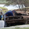 Law enforcement officials from multiple agencies examine the two cars pulled from Foss Lake, in Foss, Okla., Wednesday, Sept. 18, 2013. The Oklahoma State Medical ExaminerÂ's Office says authorities have recovered skeletal remains of multiple bodies in the Oklahoma lake where the cars were recovered. (AP Photo/Sue Ogrocki) ORG XMIT: OKSO105