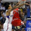 Chicago Bulls\' Nate Robinson, right, goes up for a basket past Los Angeles Clippers\' Matt Barnes in the first half of an NBA basketball game in Los Angeles, Saturday, Nov. 17, 2012. (AP Photo/Jae C. Hong)