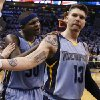 Photo - Memphis Grizzlies forward Zach Randolph (50) pats teammate Mike Miller (13) on the head after Game 5 of an opening-round NBA basketball playoff series against the Oklahoma City Thunder in Oklahoma City, Tuesday, April 29, 2014. Memphis won 100-99 in overtime. (AP Photo)