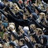 Bishop McGuinness fans raise their fingers before a kickoff during a high school football game between Bishop McGuinness and Guthrie at Bishop McGuinness Catholic High School in Oklahoma City, Friday, Oct. 26, 2012. Photo by Nate Billings, The Oklahoman