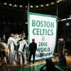 The Boston Celtics players and team personnel gather around to raise the Celtics\' 17th NBA Championship banner during ceremonies prior to their opening night NBA basketball game against the Cleveland Cavaliers in Boston, Tuesday, Oct. 28, 2008. (AP Photo/Winslow Townson) ORG XMIT: MAEA101