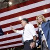 Republican presidential candidate and former Massachusetts Gov. Mitt Romney holds his wife Ann\'s hand as they arrive to campaign at the International Exposition Center in Cleveland, Sunday, Nov. 4, 2012. (AP Photo/Charles Dharapak)