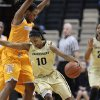 Photo - Vanderbilt guard Christina Foggie (10) drives around Tennessee forward Bashaara Graves in the first half of an NCAA college basketball game on Sunday, Jan. 12, 2014, in Nashville, Tenn. (AP Photo/Mark Humphrey)