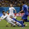 Photo - England's Adam Lallana, left, is fouled during the group D World Cup soccer match between England and Italy at the Arena da Amazonia in Manaus, Brazil, Saturday, June 14, 2014. Italy won the match 2-1. (AP Photo/Matt Dunham)