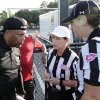 Photo - In a photo provided by the NFL, Houston coach Brian Wiggins listens as referee Shannon Eastin, center, and official Catherine Conti give pre-game instructions at the International Women's Football League Championships, Saturday, July 26, 2014. in Rock Hill, S.C. The 38-year-old Conti had been assigned to the Southeast Missouri State-Kansas game on Sept. 6, making her the first woman to work a football game in the Big 12 Conference. Conti will work mostly as a line judge in the Mountain West for the second straight year. She landed the Big 12 gig through the league's officiating partnership with the Mountain West and FCS-level Southland Conference. (AP Photo/NFL, Bob Leverone)