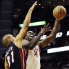 Houston Rockets\' Patrick Patterson (54) goes to the basket against Miami Heat\'s Shane Battier (31) in the second half of an NBA basketball game, Monday, Nov. 12, 2012, in Houston. The Heat won 113-110.(AP Photo/Pat Sullivan)