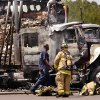 Two tractor-trailer rigs burned about 2 p.m. Thursday , July 18, 2011. The trucks were parked beside each other in a truck stop parking lot on the southeast corner of NE 122 and Interstate 35. The fire apparently started in one of the trucks and it spread to the other truck. Flames destroyed both rigs. The fire produced a tall column of thick black smoke that could be seen for several miles from the fire scene. There were no reported injuries. Photo by Jim Beckel, The Oklahoman