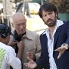 "This image released by Warner Bros shows Alan Arkin, left, and actor-director Ben Affleck on the set of ""Argo."" Affleck was nominated Thursday, Dec. 13, 2012 for a Golden Globe for best director for the film. The 70th annual Golden Globe Awards will be held on Jan. 13. (AP Photo/Warner Bros., Claire Folger) ORG XMIT: NYET740"