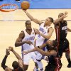 Oklahoma City\'s Russell Westbrook (0) takes the ball to the hoop against Miami\'s Chris Bosh (1), middle, Dwyane Wade (3) and Mario Chalmers (15) as Oklahoma City\'s Serge Ibaka (9) looks on in the fourth quarter during Game 2 of the NBA Finals between the Oklahoma City Thunder and the Miami Heat at Chesapeake Energy Arena in Oklahoma City, Thursday, June 14, 2012. Miami won, 100-96. Photo by Nate Billings, The Oklahoman