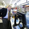 Photo -  U.S. Sen. Dick Durbin, D-Ill., talks to Walgreens clerk Estella Washington as he shops after a news conference Wednesday in Chicago.  AP Photo   M. Spencer Green -  AP