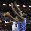 Memphis Grizzlies guard Mike Conley (11) drives against Oklahoma City Thunder center Nazr Mohammed, right, during the second half of Game 6 of a second-round NBA basketball playoff series on Friday, May 13, 2011, in Memphis, Tenn. (AP Photo/Lance Murphey)