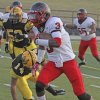 Del City\'s Corey Lawrence, right, carries the ball as Lawton MacArthur\'s Miguel Rosario defends during a Sept. 20, 2012 game in Lawton. PHOTO BY BRANDON NERIS, THE LAWTON CONSTITUTION