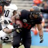 Oklahoma State\'s Jeremy Smith (31) gets by Purdue\'s Max Charlot (34) during the Heart of Dallas Bowl football game between the Oklahoma State University (OSU) and Purdue University at the Cotton Bowl in Dallas, Tuesday,Jan. 1, 2013. Photo by Sarah Phipps, The Oklahoman