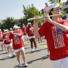 The Edmond Santa Fe Marching Band plays during the Edmond LibertyFest Parade in downtown Edmond, Okla., on Independence Day, Friday, July 4, 2014. Photo by Nate Billings, The Oklahoman