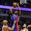 Detroit Pistons guard Rodney Stuckey (3) shoots over Chicago Bulls forward Carlos Boozer, left, and guard Marco Belinelli during the first half of an NBA basketball game, Wednesday, Jan. 23, 2013, in Chicago. (AP Photo/Charles Rex Arbogast)