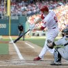 Photo -   Philadelphia Phillies' Chase Utley hits a home run in front of Pitsburgh Pirates catcher Michael McKenry in the first inning of a baseball game Wednesday, June 27, 2012, in Philadelphia. (AP Photo/Michael Perez)