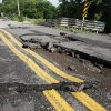 This bridge on Covell Road between Western and Pennsylvania in Edmond, OK, was washed out by yesterday\'s torrential rains, Tuesday, June 15, 2010. By Paul Hellstern, The Oklahoman