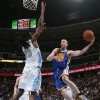 Photo - Golden State Warriors guard Steve Blake, right, prepares to pass around Denver Nuggets forward Kenneth Faried during the first quarter of an NBA basketball game in Denver on Wednesday, April 16, 2014. (AP Photo/David Zalubowski)