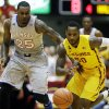 Photo - Iowa State guard DeAndre Kane, right, runs down a loose ball ahead of Kansas forward Tarik Black during the first half of an NCAA college basketball game, Monday, Jan. 13, 2014, in Ames, Iowa. (AP Photo/Charlie Neibergall)