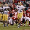 Notre Dame\'s Kapron Lewis-Moore (89), Prince Shembo (55), and Stephon Tuitt (7) celebrate in front of OU\'s Landry Jones (12) after the last play of the the college football game between the University of Oklahoma Sooners (OU) and the Notre Dame Fighting Irish at Gaylord Family-Oklahoma Memorial Stadium in Norman, Okla., Saturday, Oct. 27, 2012. Oklahoma lost 30-13. Photo by Bryan Terry, The Oklahoman