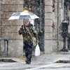 Christopher Manis uses an umbrella to protect himself from heavy snow falling in downtown Roanoke, Va., on Thursday afternoon Jan. 17, 2013. Virginia is bracing for the first significant snowstorm of the winter season. (AP PHOTO/The Roanoke Times, Kyle Green) LOCAL TV OUT; SALEM TIMES REGISTER OUT; FINCASTLE HERALD OUT; CHRISTIANBURG NEWS MESSENGER OUT; RADFORD NEWS JOURNAL OUT; ROANOKE STAR SENTINEL OUT