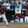 Photo - Tuttle holds a sign for a team mate during the class 4A state baseball championship game between Tuttle and Dewey at the Chickasaw Bricktown Ballpark in Oklahoma City, Saturday, May 17, 2014. Photo by Sarah Phipps, The Oklahoman