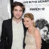 Photo - Actors  Robert  Pattinson, left, and Emilie de Ravin attend the premiere of 'Remember Me' at the Paris Theater on Monday, March 1, 2010 in New York. AP Photo
