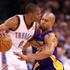 OKLAHOMA CITY THUNDER / LOS ANGELES LAKERS / NBA BASKETBALL: Los Angeles Lakers guard Derek Fisher tries to steal the ball from Oklahoma City Thunder guard Russell Westbrook during the Thunder - Lakers game November 3, 2009 in the Ford Center in Oklahoma City. BY HUGH SCOTT, THE OKLAHOMAN ORG XMIT: KOD