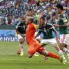 Photo - Netherlands' Arjen Robben, center, goes down to win a penalty during the World Cup round of 16 soccer match between the Netherlands and Mexico at the Arena Castelao in Fortaleza, Brazil, Sunday, June 29, 2014. Netherlands won the match 2-1. (AP Photo/Wong Maye-E)