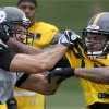 Photo - Pittsburgh Steelers tight end Matt Spaeth, left, competes in a one-on-one drill against  linebacker Jarvis Jones during NFL football training camp in Latrobe, Pa., on Wednesday, July 31, 2013 . (AP Photo/Keith Srakocic)