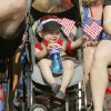 Two year old Cohen Copeland waves a flag during the annual LibertyFest Fourth of July Parade in downtown Edmond, OK, Thursday, July 4, 2013, Photo by Paul Hellstern, The Oklahoman