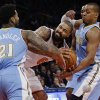 Photo - Denver Nuggets' Wilson Chandler (21) and Randy Foye (4) fight for control of the ball with New York Knicks' Tyson Chandler (6) during the first half of an NBA basketball game Friday, Feb. 7, 2014, in New York. (AP Photo/Frank Franklin II)
