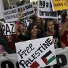People march on the streets, displaying banners and Palestinian flags, as they shout anti Israeli slogans, during a protest against the Israeli airstrikes of the Gaza strip, in Madrid, Spain, Thursday, July 17, 2014. About 2,000 people took part in the demonstration. (AP Photo/Daniel Ochoa de Olza)