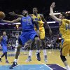 Dallas Mavericks guard Vince Carter (25) drives to the basket between New Orleans Hornets forward Al-Farouq Aminu (0) and forward Jason Smith (14) in the second half of an NBA basketball game in New Orleans, Friday, Feb. 22, 2013. The Mavericks won 104-100. (AP Photo/Gerald Herbert)