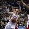 Whitney Hand is fouled while driving to the baskey in the second half as the University of Oklahoma plays Louisville at the 2009 NCAA women\'s basketball tournament Final Four in the Scottrade Center in Saint Louis, Missouri on Sunday, April 5, 2009. Photo by Steve Sisney, The Oklahoman