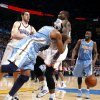 Denver\'s Nene (31) pushes Oklahoma City\'s Kendrick Perkins (5) during the NBA basketball game between the Oklahoma City Thunder and the Denver Nuggets, Friday, April 8, 2011, at the Oklahoma City Arena.. Photo by Sarah Phipps, The Oklahoman