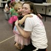 Tippi Toes Oklahoma Director Brittany Friske gets a hug from Madeline Davis, 2, of Norman, after Tippi Toes Dance Company\'s Mommy and Me class for kids ages eighteen months to 3 years at the Moore Community Center in Moore, Okla., on Tuesday, Feb. 17, 2009. By John Clanton, The Oklahoman