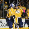Photo - Nashville Predators goalie Pekka Rinne (35), of Finland,  and defenseman Shea Weber (6) celebrate after defeating the Calgary Flames 4-3 in an NHL hockey game, Tuesday, April 23, 2013, in Nashville, Tenn. (AP Photo/Mike Strasinger)
