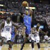Oklahoma City Thunder guard Russell Westbrook (0) drives past Memphis Grizzlies forward Zach Randolph (50) and O. J. Mayo (32) during the first half of Game 6 of a second-round NBA basketball playoff series on Friday, May 13, 2011, in Memphis, Tenn. (AP Photo/Lance Murphey)