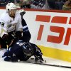 Photo - Anaheim Ducks' Nick Bonino (13) crushes Winnipeg Jets' Evander Kane (9) during second period NHL hockey action in Winnipeg, Manitoba, Sunday, Oct. 6, 2013. (AP Photo/The Canadian Press, Trevor Hagan)