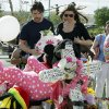 Actor Christian Bale and his wife Sibi Blazic view a cross and large display of flowers and stuffed animals dedicated to Veronica Moser-Sullivan, 6, the youngest of the 12 victims of Friday\'s mass shooting, Tuesday, July 24, 2012, at a memorial in Aurora, Colo. Twelve people were killed when a gunman opened fire during a late-night showing of the movie