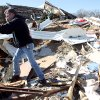 Tim Bondie sorts through what\'s left of his brother in law\'s home following deadly storms around Lone Grove, Okla., Feb. 11, 2009. By John Clanton, The Oklahoman