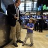 Photo - Tripp Mancuso, 4, works with his trader father Peter Mancuso on the floor of the New York Stock Exchange, during the NYSE Working Parents/Caregivers Employee Resource Group's annual Take Your Child to Work Day program, Thursday, April 24, 2014. Mixed earnings from a large number of U.S. companies left the stock market without direction early Thursday, despite positive results from a handful of names including Apple and Caterpillar. (AP Photo/Richard Drew)