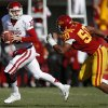 Oklahoma\'s Landry Jones (12) tries to get away from Iowa State\'s Willie Scott (50) during a college football game between the University of Oklahoma (OU) and Iowa State University (ISU) at Jack Trice Stadium in Ames, Iowa, Saturday, Nov. 3, 2012. Photo by Bryan Terry, The Oklahoman