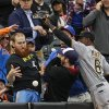 Photo - Pittsburgh Pirates left fielder Starling Marte (6) fights with fans for control of a foul ball hit by New York Mets' Daniel Murphy during the seventh inning of a baseball game Wednesday, May 28, 2014, in New York. (AP Photo/Frank Franklin II)