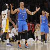 Oklahoma City Thunder guard Russell Westbrook, center, reacts after missing a last second shot as Los Angeles Lakers center Jordan Hill, left, and Thunder guard Thabo Sefolosha look on in the first overtime of their NBA basketball game, Sunday, April 22, 2012, in Los Angeles. (AP Photo/Mark J. Terrill) ORG XMIT: LAS301
