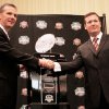 Florida coach Urban Meyer, left, and Oklahoma coach Bob Stoops shake hands in front of the BCS championship trophy on Wednesday. AP Photo