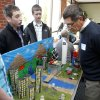 Sequoyah Middle School students Cooper Coil (left) and Brendan Bussell explain the workings of their city